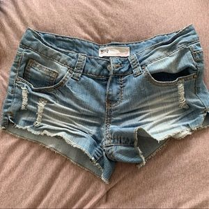 Light wash distressed mid rise shorts